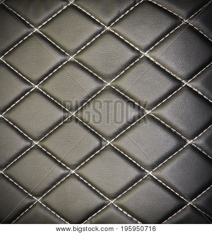 Genuine leather upholstery background for a luxury decoration in black tones