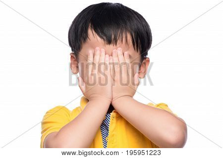 Young Asian Boy Shy Or Scared, Hide His Eyes By Hands.