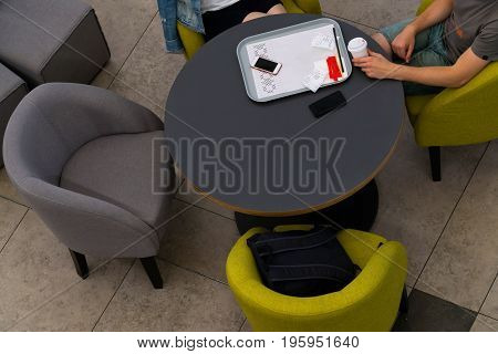 Top view of people sitting at a table in a cafe. Self-service Cafe.