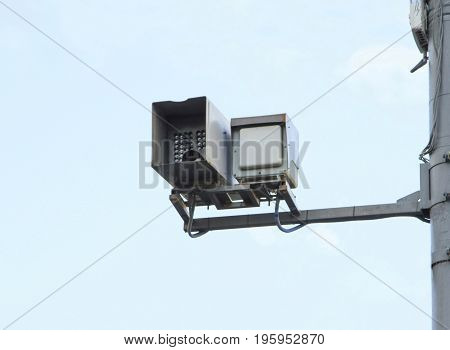 speed control camera on a pole over blue sky