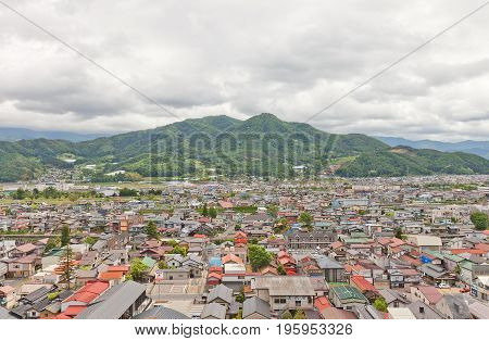 KAMINOYAMA JAPAN - MAY 28 2017: View of Sankichiyama Mount and Kaminoyama City from donjon of Kaminoyama Castle. Modern Kaminoyama was established in 1889 and was elevated to city status in 1954
