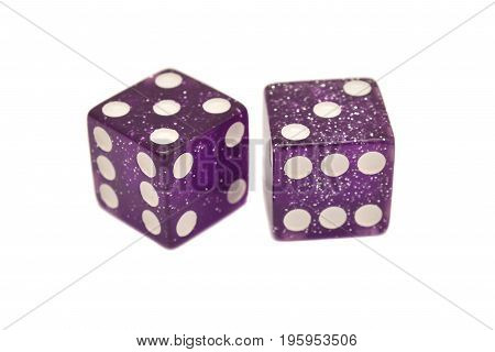 a pair of purple casino dice isolated on white