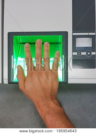 Man uses a high-tech device for identification.