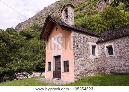 Biasca, Switzerland - 25 July 2016: Church at Santa Petronilla waterfalls in Biasca Cantone Ticino Switzerland