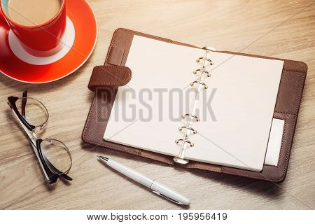 Blank White Notebook Open, Pen And Cup Of Coffee On The Desk