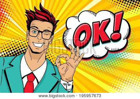Wow pop art male face. Young hansome man in glasses smiles winks and shows okay sign and OK! speech bubble. Vector illustration in retro comic style. Vector pop art background. Invitation poster.