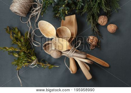 Wooden spoons on a dark black background.