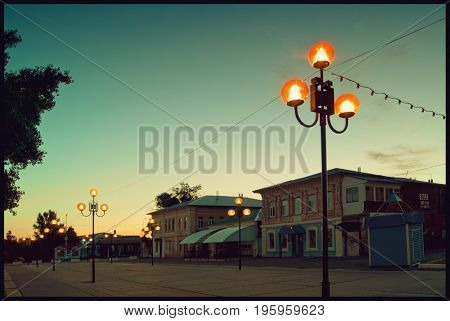 The old town street in Balashov at dawn. Facades of old houses built before 1900.