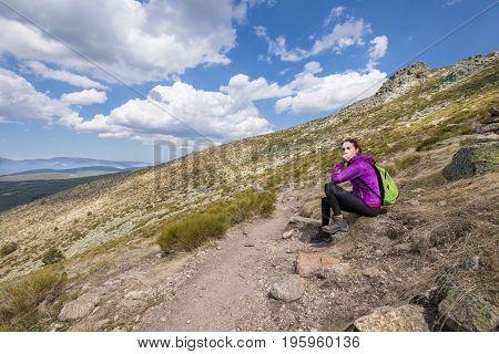 Hiker Woman Resting Sitting In Footpath Guadarrama
