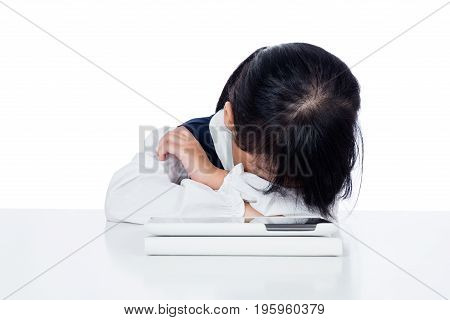 Asian Chinese Little Girl In Uniform Playing With Tablet Computer