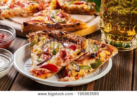 Slices Of Pizza With Bacon, Paprika And Corn
