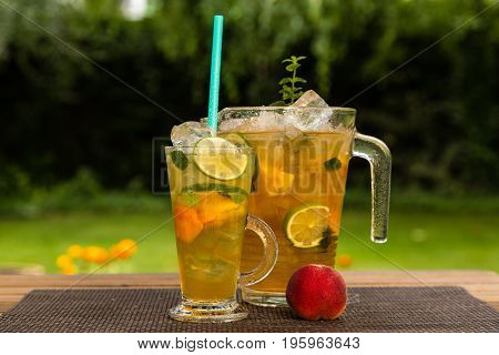 Homemade Peach Ice Tea With Lime And Lemon Balm