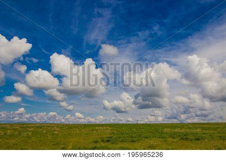 Steppe In Spring, Kazakhstan. Amazing Clouds And Sky
