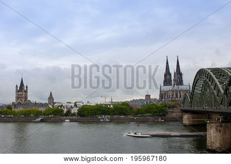 View of Cologne cathedral and Hohenzollern bridge over Rhine river Germany