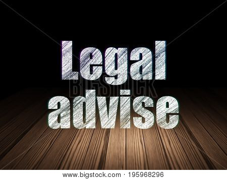 Law concept: Glowing text Legal Advise in grunge dark room with Wooden Floor, black background