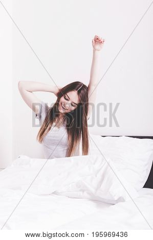 Girl Yawning In Bed.