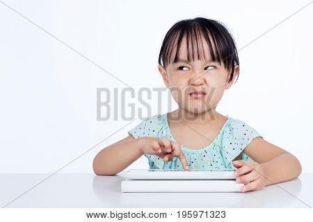 Asian Chinese Little Girl Playing With Tablet Computer