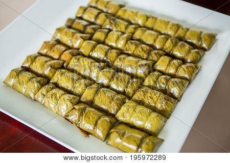 Kow Tom Mad. Thai steamed dessert made from sticky rice and banana wrapped in banana leaves