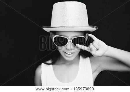 Little Girl Rocker With Sunglasses And Hat On A Black Background