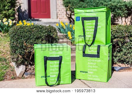 Fairfax USA - March 2 2017: Amazon Fresh insulated grocery delivery bags on front porch closeup