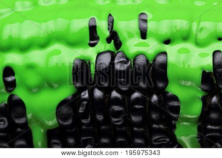 Black Corn With Pouring Green Paint Background, Macro Closeup.texture