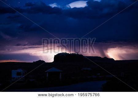 Night Sky During The Thunderstorm In The Distance With Canyons And Campground