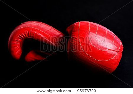 Red Leather Boxing Gloves Isolated On Black Background