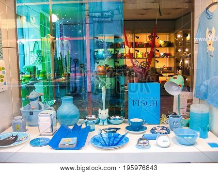Zurich Switzerland - August 9 2007: View on window display from the street on home goods store Sibler AG selling kitchen utensil in blue unicolor