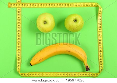 Banana And Green Apples With Tape Making Eyes And Mouth