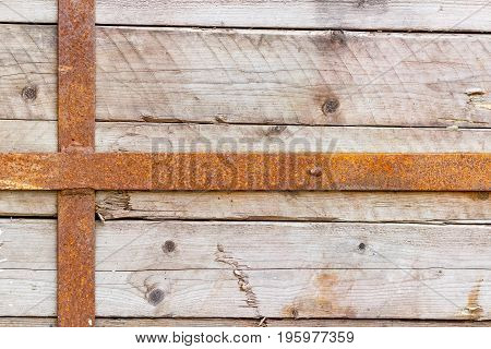 Vintage Weathered Wooden Boards Fastened With Rusty Metal Stripes. Natural Wood Texture. Abstract Ba