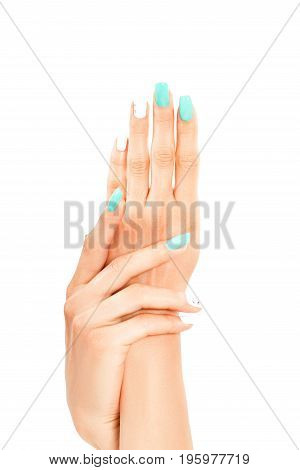 Well-groomed female hands with mint-white manicure, isolated on a white background