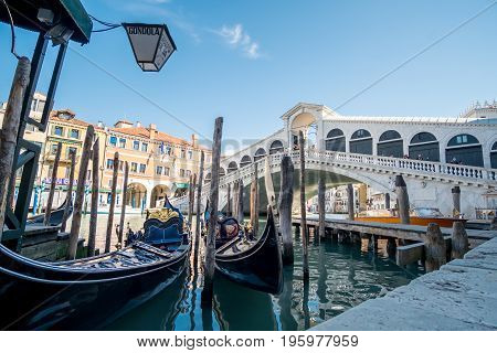 Venice Italy - 21 May 2017 : View of Gondola with building along the Grand canal at Rialto Bridge in Venice.