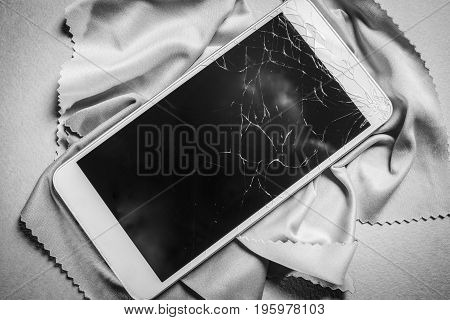 Broken mobile phone screen black and white frame