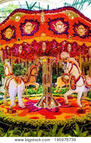Las Vegas, Usa - May 7, 2014: Wynn Hotel Decorated With Rose Flowers And Carousel With Horses Inside