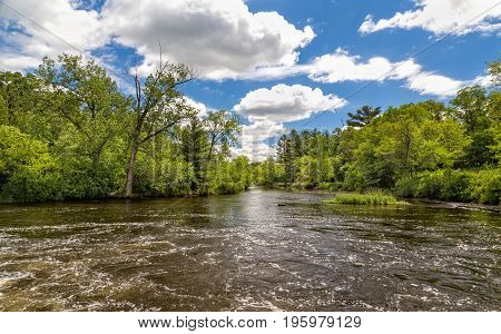 Flowing Apple River in Amery Wisconsin USA.