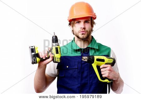 Construction worker holds yellow building tools. Finished work and repairing concept. Man with beard confident face expression. Builder in orange helmet and blue uniform isolated on white background