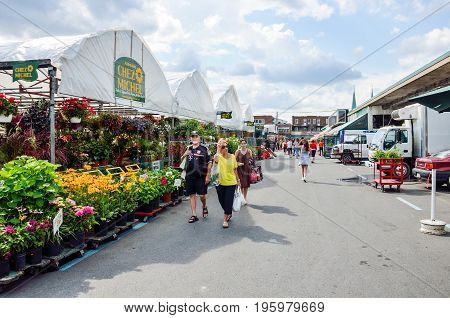 Montreal, Canada - July 26, 2014: People Walking By Produce Vegetable Stands Outside During Bright S