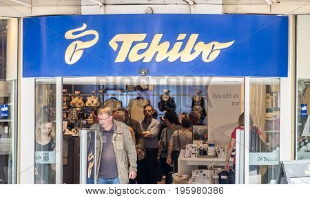 HAMBURG , GERMANY - JULY 14, 2017: Customers enjoying the offering of the Tchibo store in the city