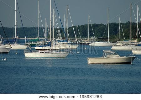 Bristol Rhode Island USA - July 24 2005: Moored sailboats pointing into wind in Bristol harbor on summer morning