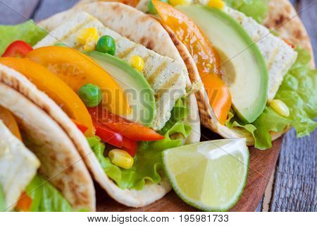 Vegetarian fajitas with tofu and vegetables. Love for a healthy vegan food concept.