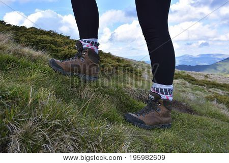 hiking boots in the mountains. All terrain shoes