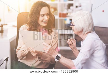 What do you think. Clever practical ambitious woman talking to her colleague seeking consultation and asking about for thoughts