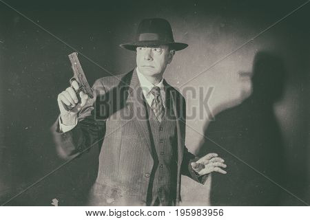 Antique Black And White Photo Of Film Noir 1940S Gangster Shooting With Gun.