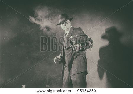 Antique Black And White Photo Of 1940S Gangster Shooting With Gun.