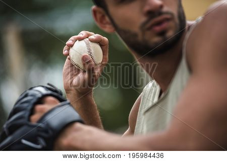 Young Handsome Man Throwing Baseball Ball On Court