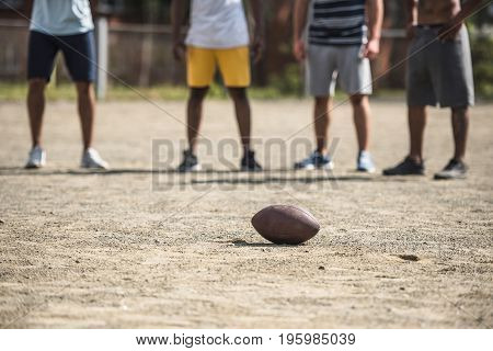 Group Of Young Multicultural Male Football Players On Court
