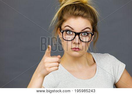 Woman Wearing Eyeglasses Pointing At Camera