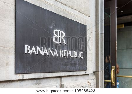 Montreal Canada - May 26 2017: Closeup of Banana Republic store sign with people going inside entrance door in downtown area in Quebec region