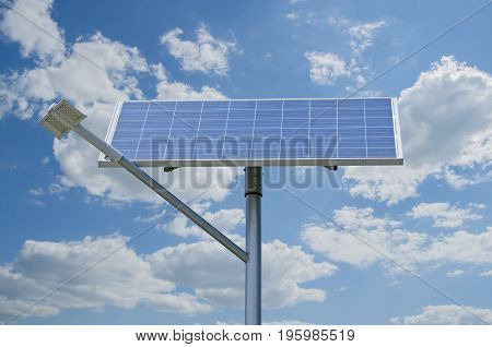 Solar battery generating electricity for street lights against a background of clouds