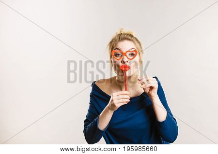 Woman Holds Carnival Accessories On Stick